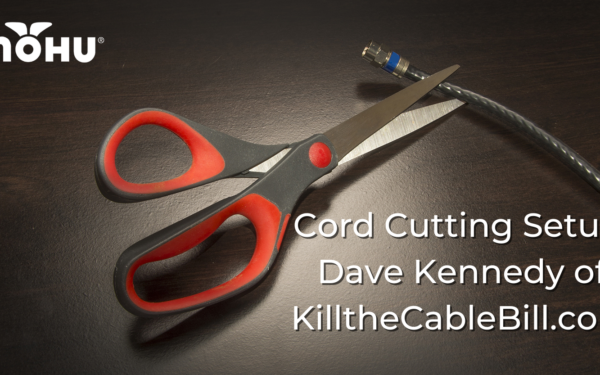 Scissors on dark background and table cutting a coaxial cable, Cord Cutting Setup Dave Kennedy of KilltheCableBill.com