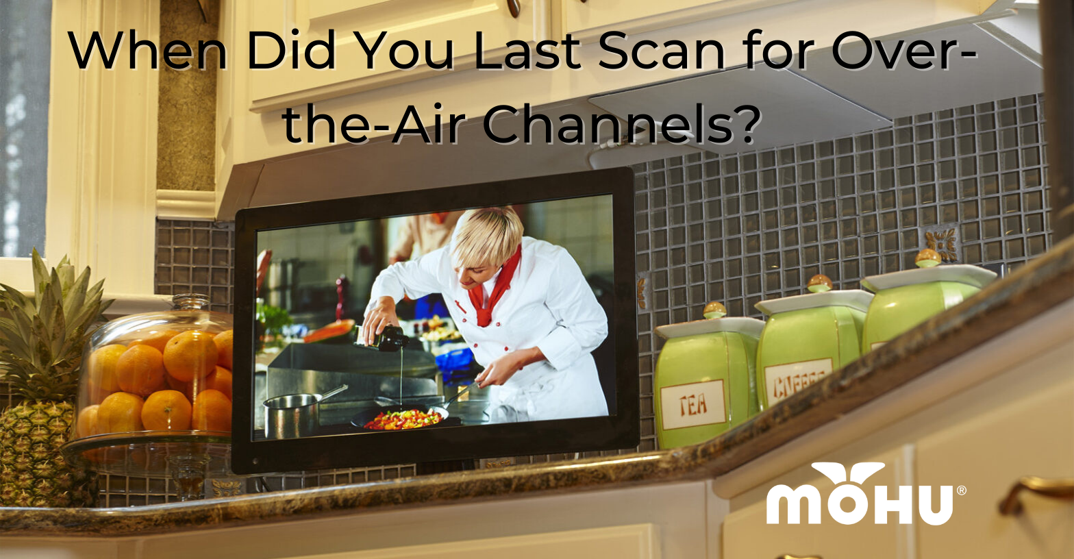 Photo of TV in kitchen, When Did You Last Scan for Over-the-Air Channels? Mohu logo