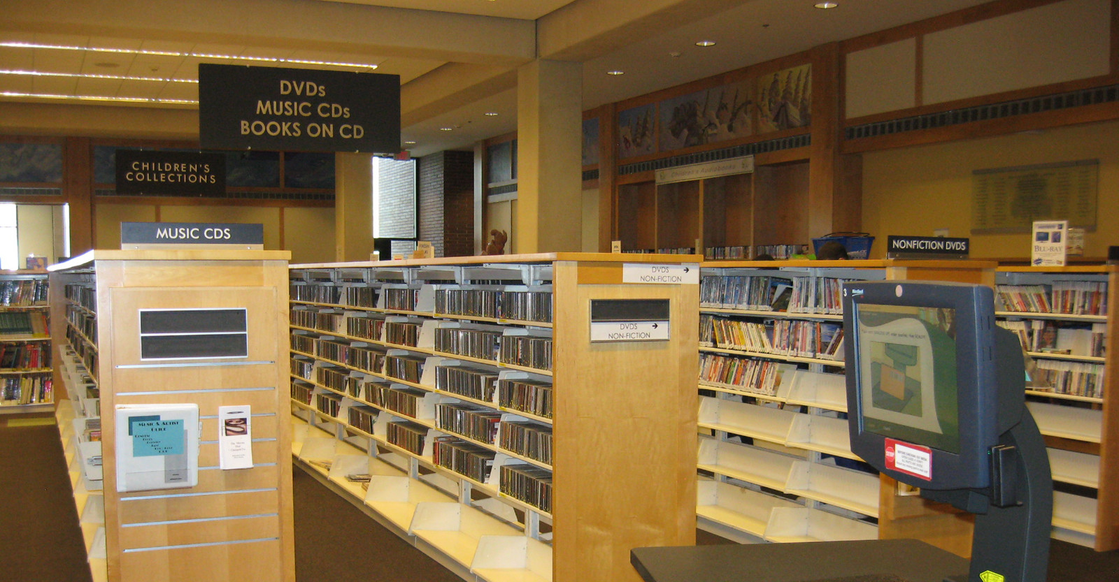 Photo showing the racks of DVD's available to rent from the library