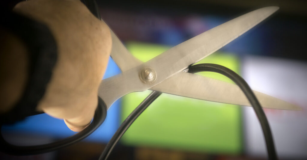 Scissors cutting cable cord
