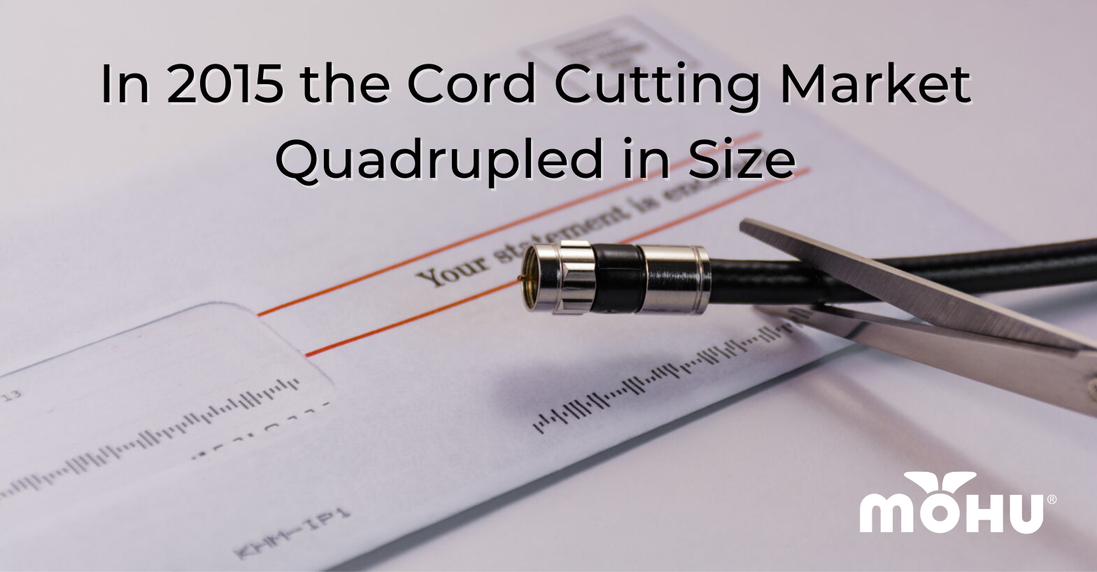 bill on table with a cord being cut on top of it, In 2015 the Cord Cutting Market Quadrupled in Size, mohu logo