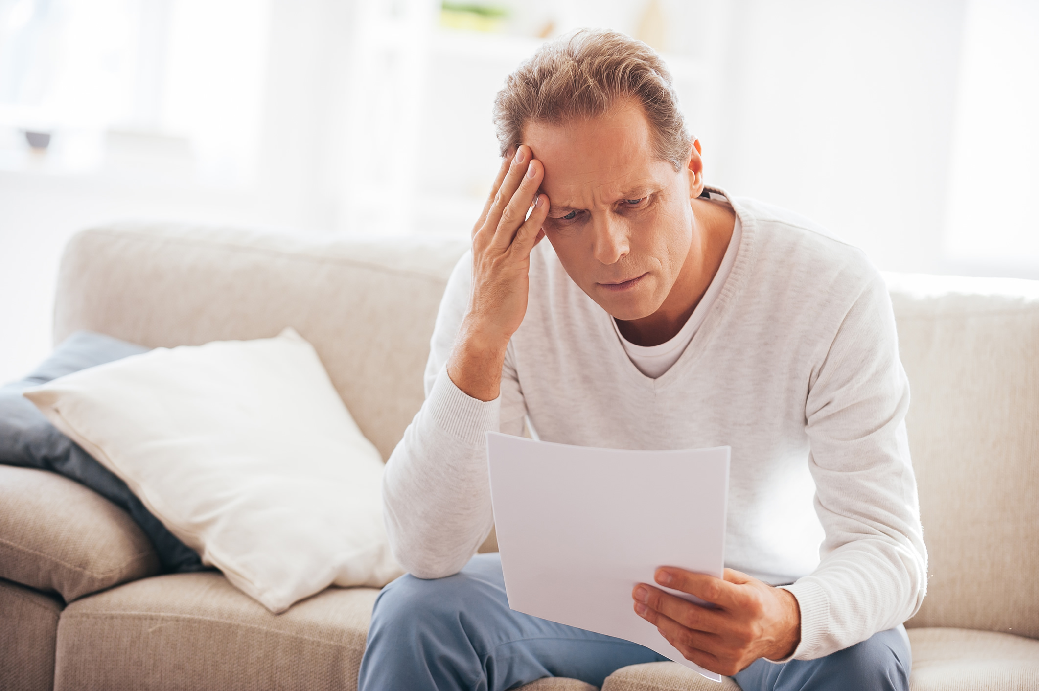 Man struggling to read cable bill