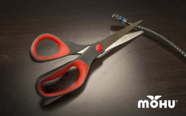Scissors cutting a coax cable with the Mohu Logo