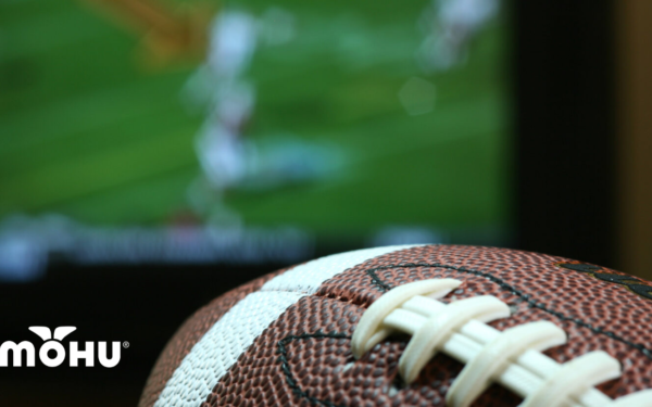 Football in front of TV screen with Mohu Logo