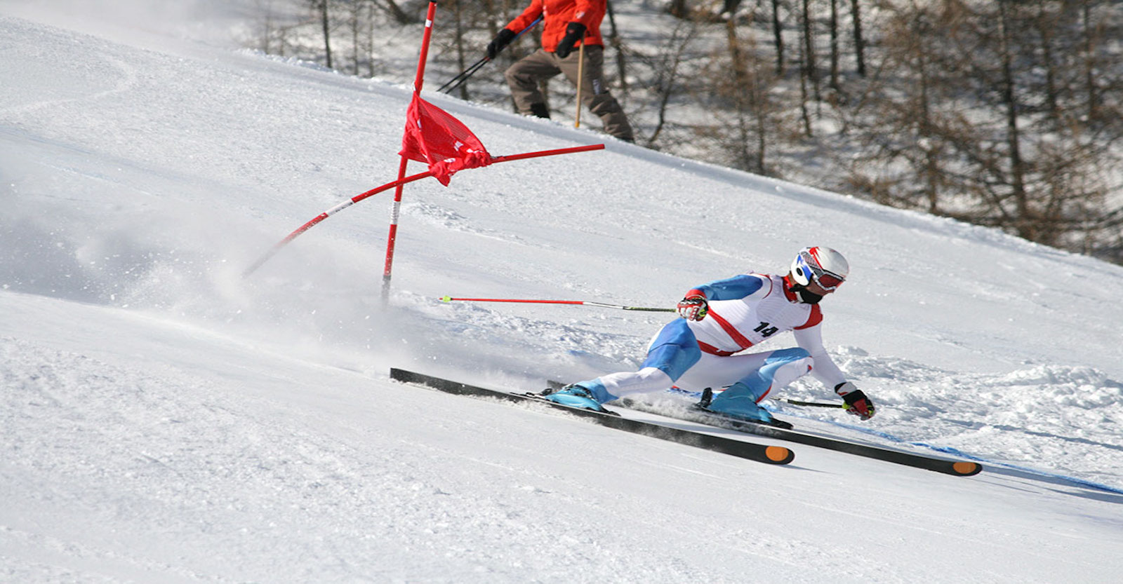 Downhill skier going through the gates