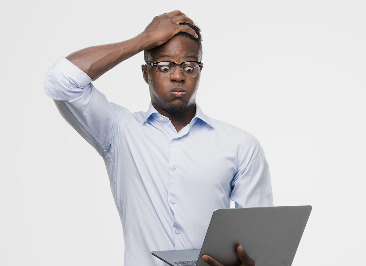 man looking very frustrated at his computer paying cable bill