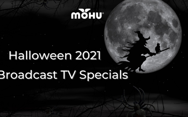 Witch riding a broom across the moon in the dark night sky. Mohu Logo. Halloween 2021 Broadcast TV Specials